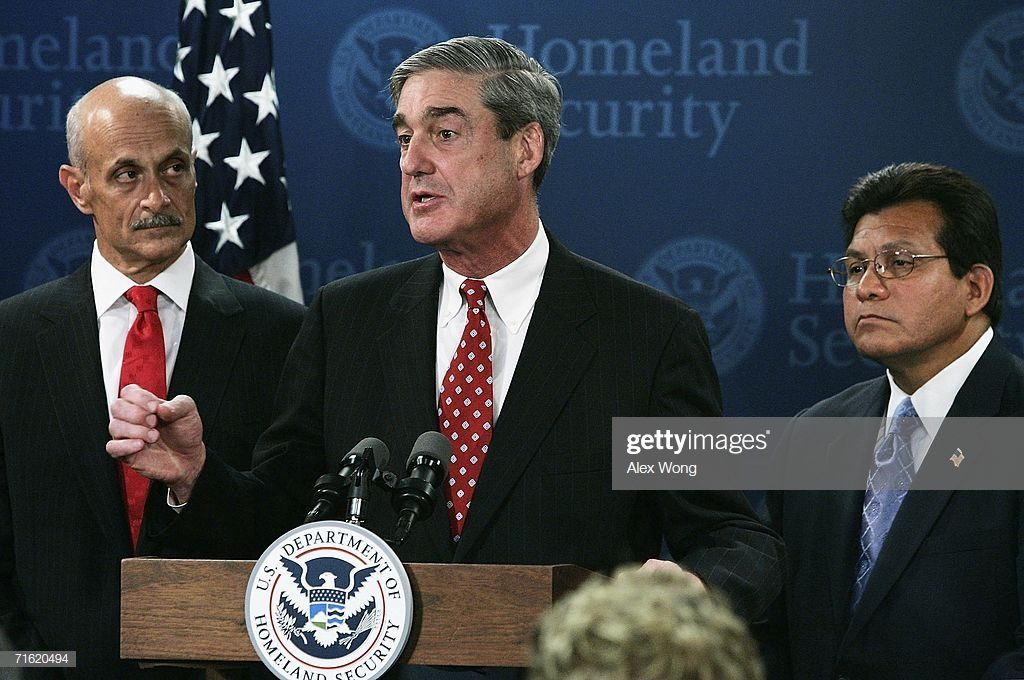WASHINGTON - AUGUST 10:  FBI Director Robert Mueller (C) speaks as U.S. Homeland Security Secretary Michael Chertoff (L) and Attorney General Alberto Gonzales (R) look on during a news conference at the Homeland Security Department August 10, 2006 in Washington, DC. This is the first time that the red alert level, which designates a